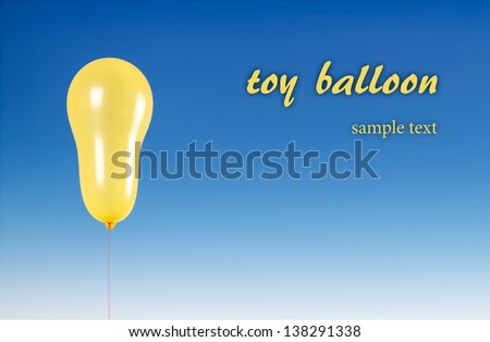 Toy balloons on a blue sky background