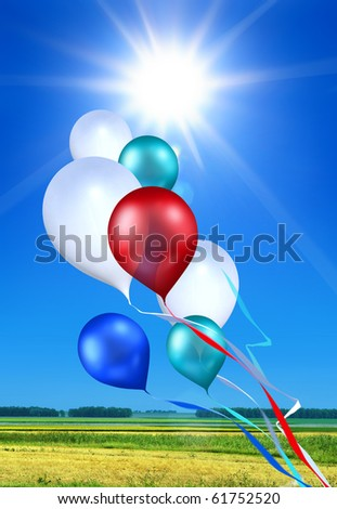 toy balloons soaring in the blue sky under shining sun