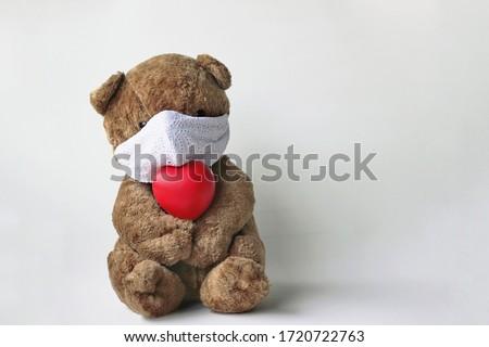 Toy bear in the mask to prevent coronavirus, Teddy bear wearing face mask protective for spreading of disease virus CoV-2 Coronavirus Disease 2019 quarantine and outbreak alert sign comcept.