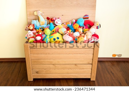Toy Box full of soft toys in a child\'s bedroom
