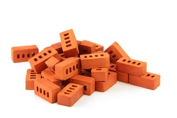toy bricks isolated on white. a pile of miniature toy bricks isolated on white background