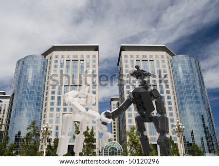 toy bricks people handshake on office building background