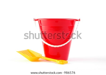 Toy bucket and shovel on white background