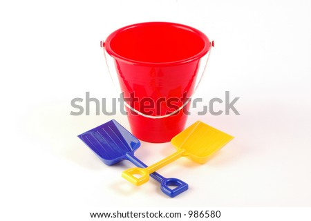 Toy bucket on white background with two shovels