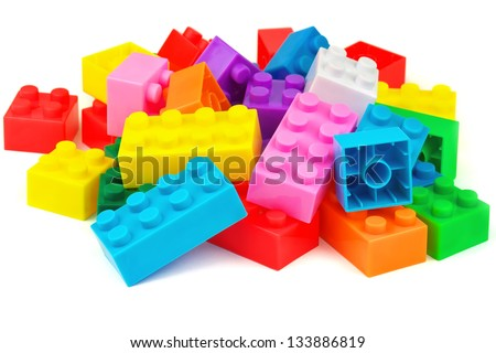 Toy building colorful blocks on white background - stock photo