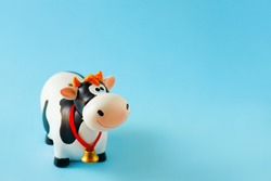 Toy bull on the blue background. Symbol of the Chinese New year 2021. New year's mood.