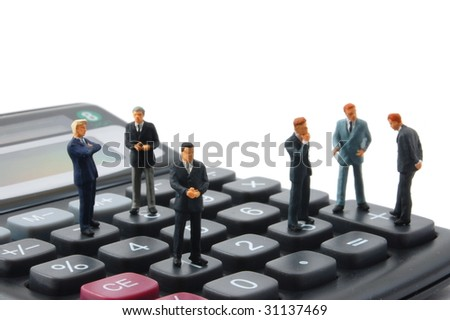 toy business man on calculator isolated on white background