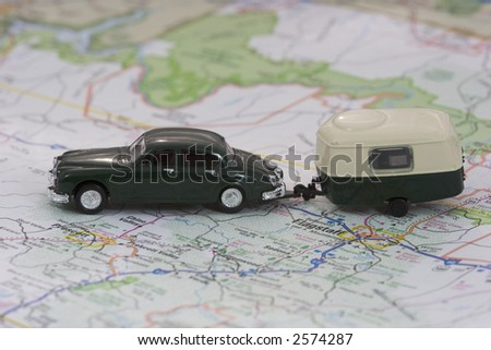 Toy Car and Camper on Map, with shallow depth of field.