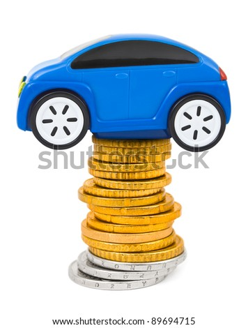 Toy car and stack of coins isolated on white background