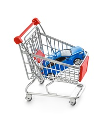 Toy car in shopping cart isolated on white background