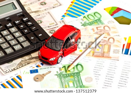 Toy car, money and other business staff