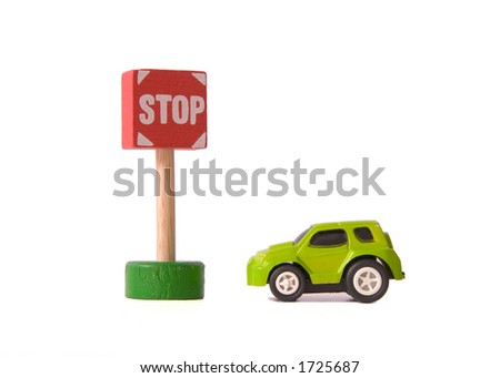 Toy Car parked next to a Toy Stop Sign