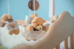 Toy carousel, above the baby bed.