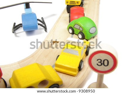 Toy cars accident on a wooden road isolated