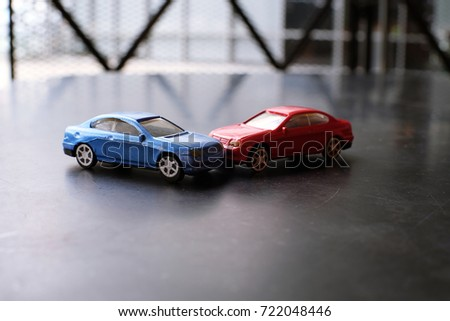 Toy cars crash accident. Simulation  red and  blue car. #722048446