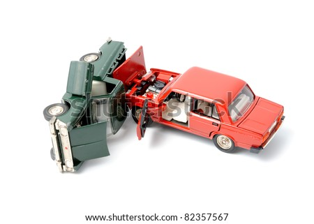 Toy cars in accident on a white background