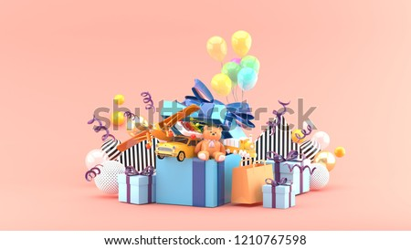Toy cars, planes, teddy bears and trains are in gift boxes amid colorful balls on a pink background.-3d rendering.