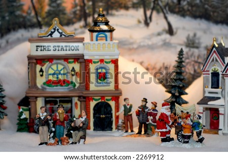Toy Christmas village with figurines and houses