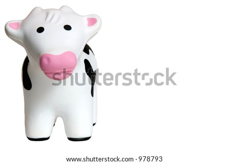 Toy cow made of foam, isolated on a white background.