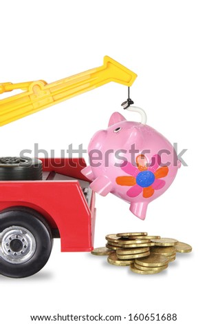 Toy Crane and Piggy Bank on White Background