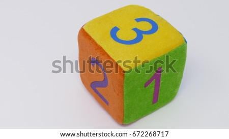 Toy dice with numbers #672268717