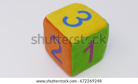 Toy dice with numbers #672269248