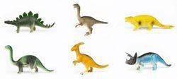 Toy dinosaurs on white background