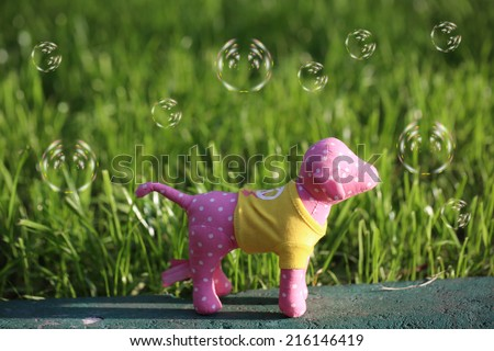 http://www.shutterstock.com/pic-216146419/stock-photo-toy-dog-grass-bright-summer-sun.html?src=mW1neXwEkG9s-AX5tNhp9A-1-99