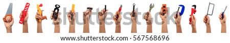 Toy engineering tools concept. Boy's hands raised holding different engineering tools, mechanic tools set isolated on white. #567568696