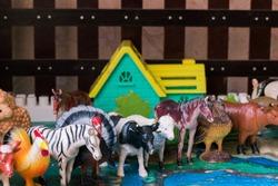 Toy farm with many animals