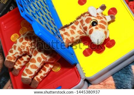 Toy Giraffe Stuck Inside a Child's Board Game