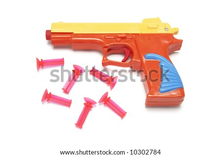 stock-photo-toy-gun-with-rubber-bullets-on-white-background-10302784.jpg