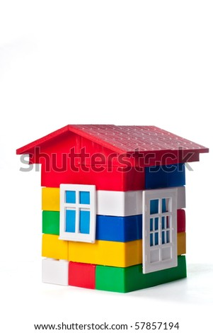 Toy house build with colorful plastic blocks isolated on white