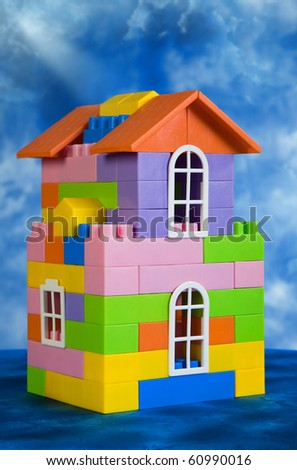 Toy house model on a blue sky background