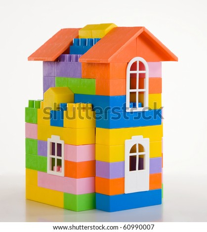 Toy house model on a white background - stock photo