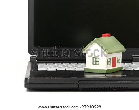 Toy House on laptop isolated on white backgroun
