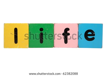 toy letters that spell life against a white background with clipping path