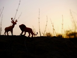 Toy Lion and deer standing together with friendly nature image concept.