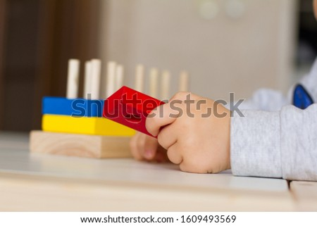 Toy made of wood for the study of shapes and colors. Useful game for a child on a white table. Montessori Education. Materials for the school. Materials on geometry. the concept of teaching children.
