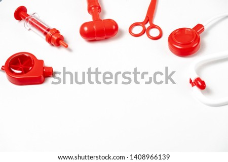 toy medical devices in a semicircle on a white background.  Kids playing profession doctor. Choice of profession #1408966139