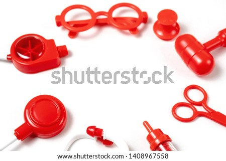 toy medical devices in a semicircle on a white background.  Kids playing profession doctor. Choice of profession #1408967558