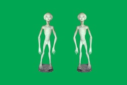 Toy model cartoon alien on green