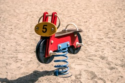 toy motorcycle on playground
