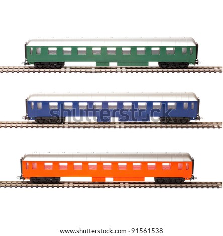 Toy passenger cars of different colors isolated over white background