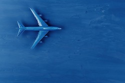 Toy plane on classic blue background, top view