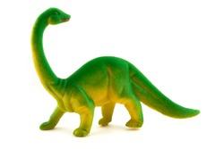 Toy plastic dinosaur over white