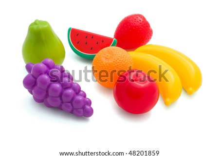 Toy plastic fruits isolated on white