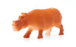 toy plastic hippopotamus isolated on white background