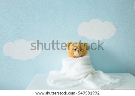 toy portrait in white wool blanket