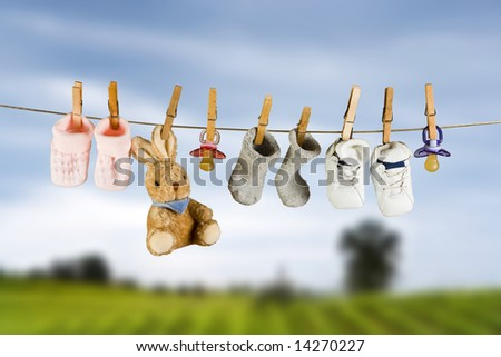 Toy rabbit and baby pacifiers hanging on a clothesline